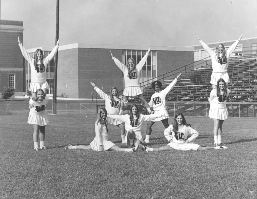 The 1972 cheerleaders in front of the library addition.