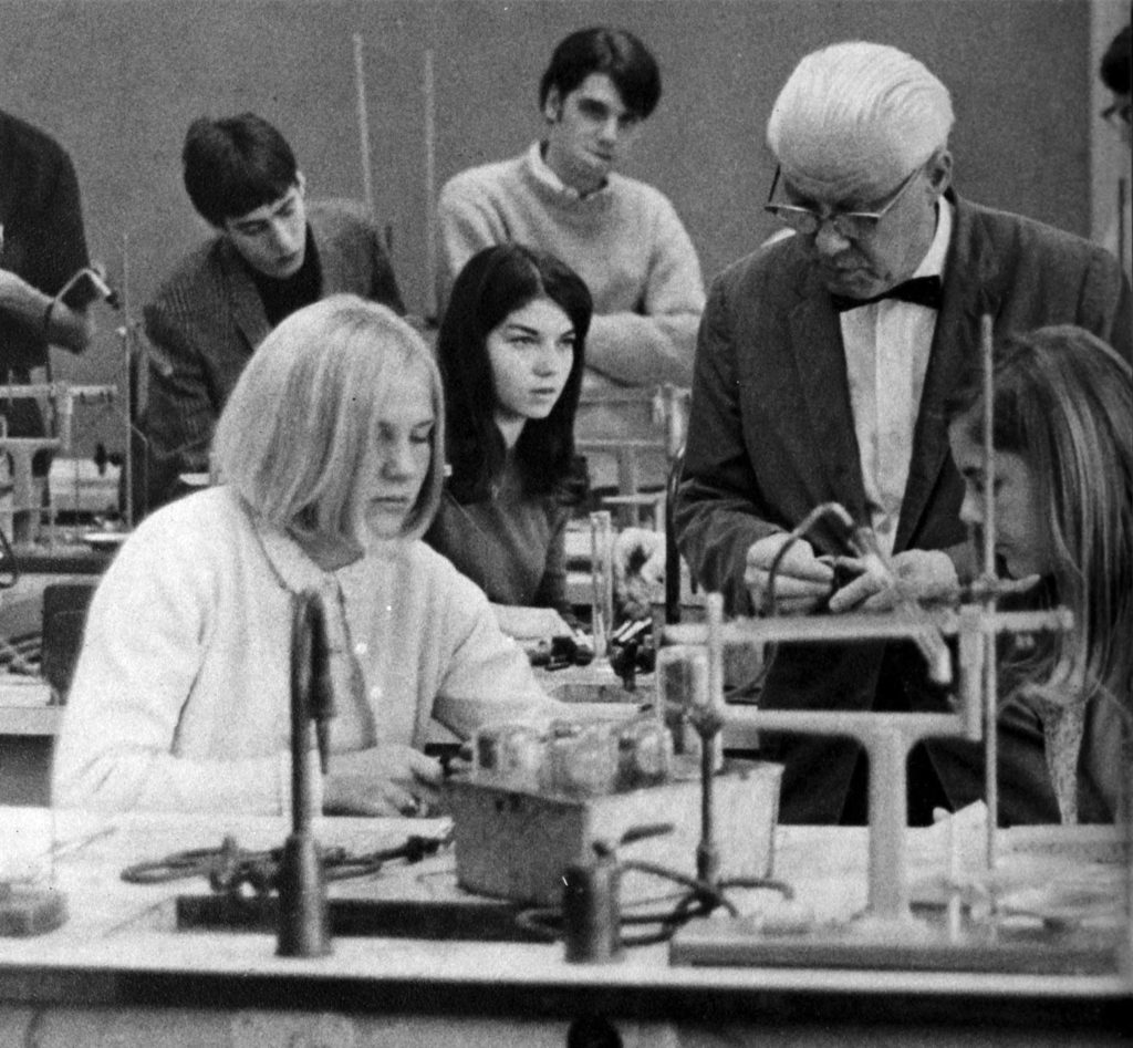 Mr. Thomas Christie assists students in his science class. Holly Hawthorne, current principal of Arlington Traditional School, is among the students pictured (1968 Blue and Gray). Mr. Thomas M. Christie and Miss Mabel Allen are the two longest serving members of the W-L faculty.
