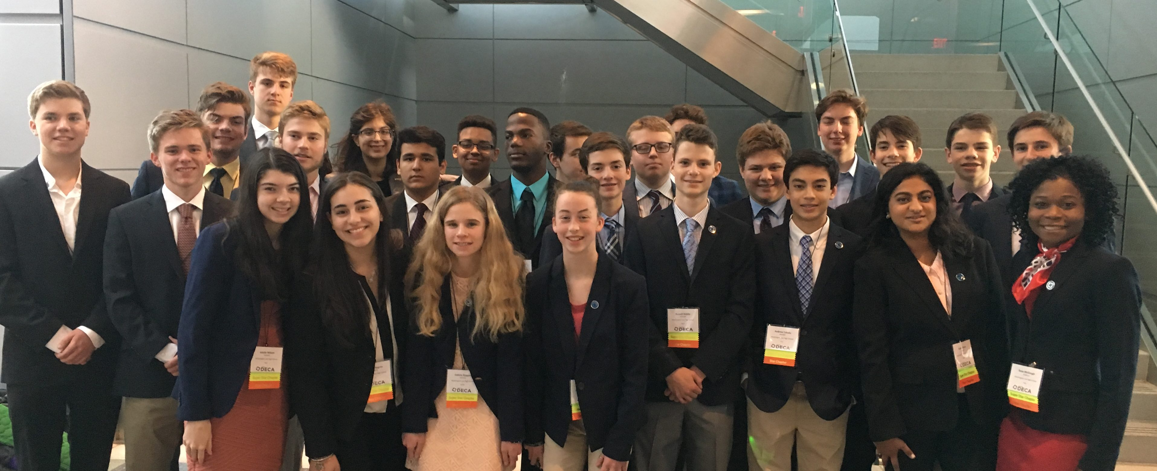 DECA Returns with 10 Medals and Four Students Advance to Nationals