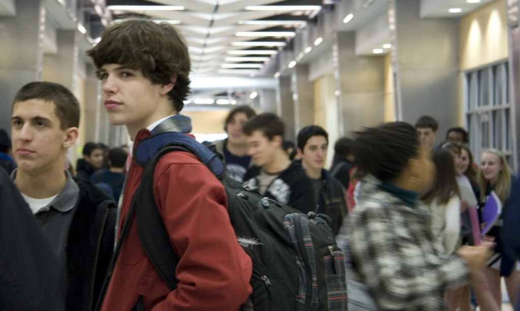 """During the first week in the brand new academic building, students congregate in the new social heart of the W-L, the ground floor concourse, or main hallway, which terminates in the """"commons."""" (Photo taken January, 2008)"""